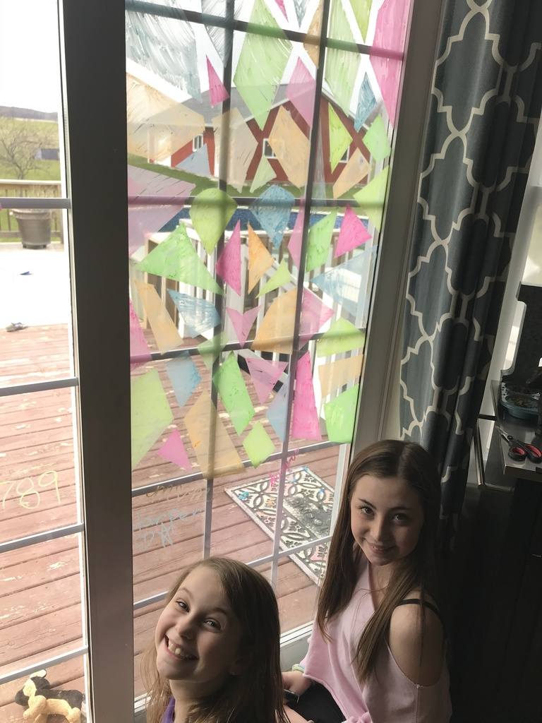 Sawyer and Harper Kerr painting their window at home
